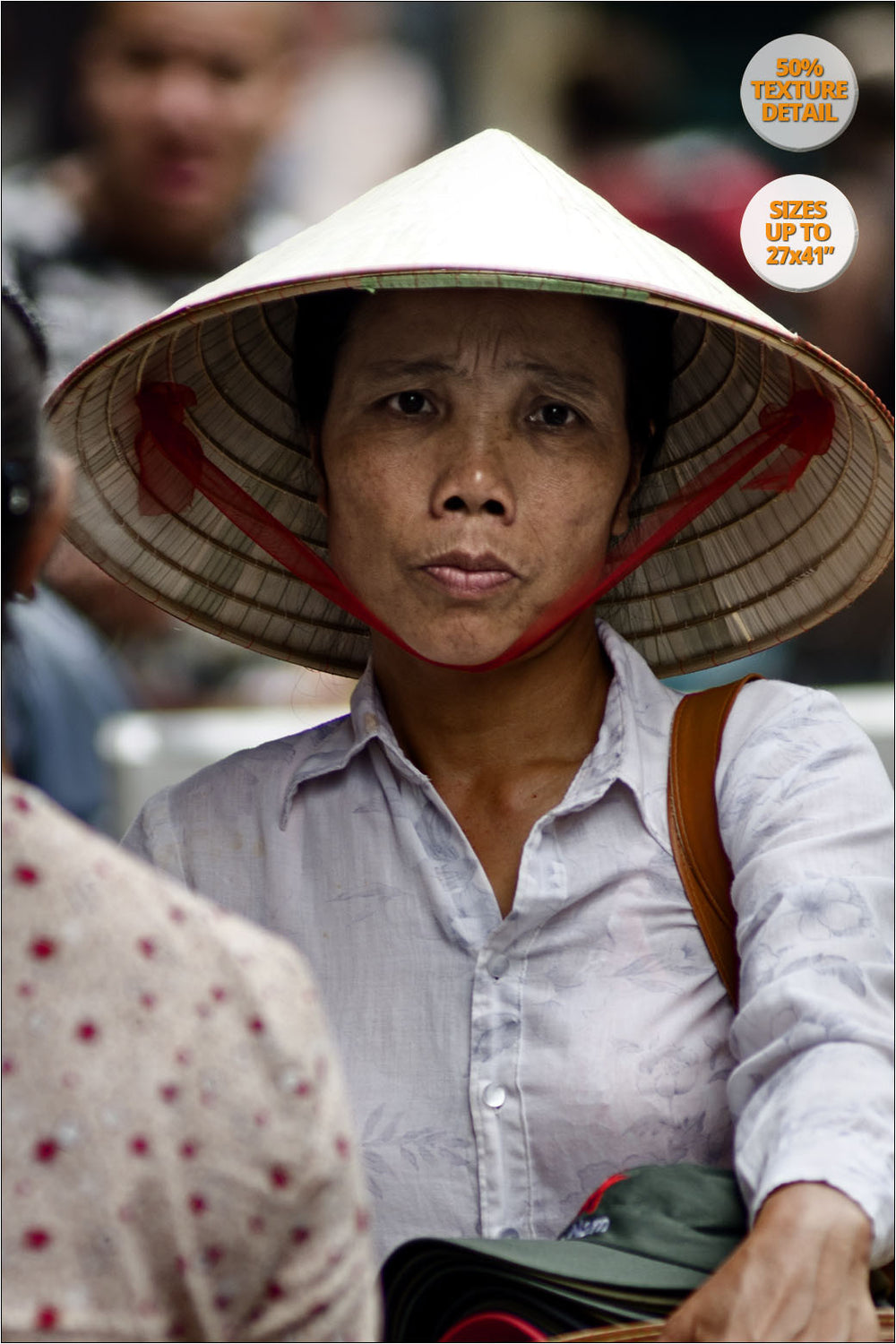 Woman selling hats in Hanoi old quarters, Vietnam. | 50% Magnification Detail.