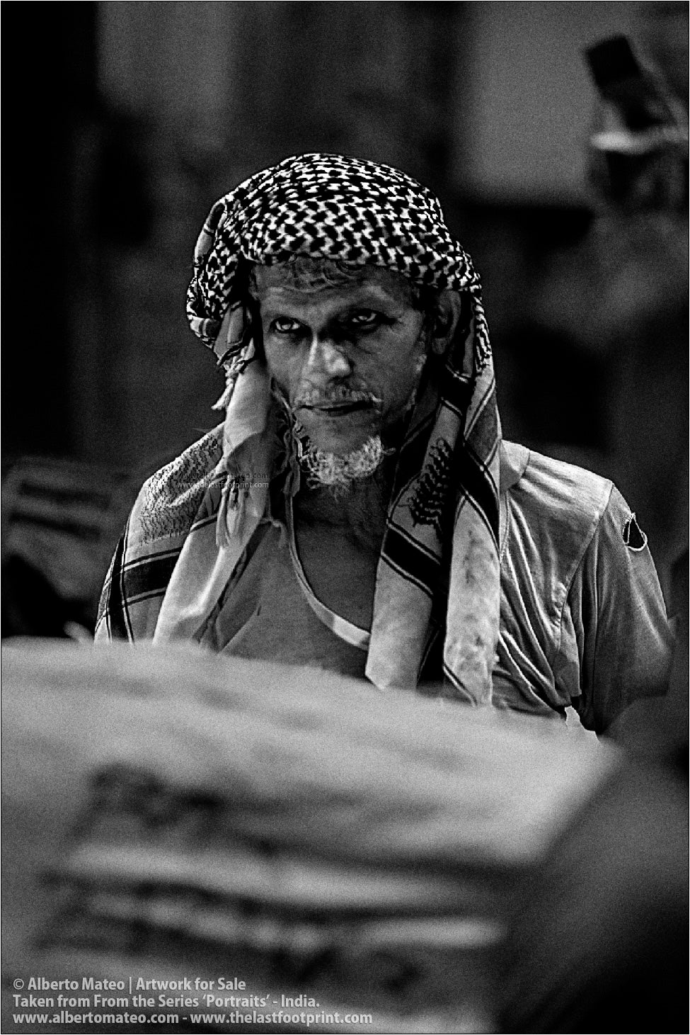 Portrait of thoughtful Porter, Bara Bazar, Kolkata, India.