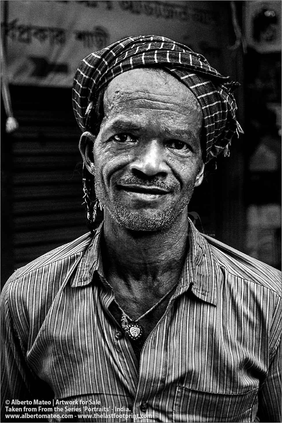 Portrait of Smiling Porter in Bara Bazar, Kolkata, India. [BLACK AND WHITE]
