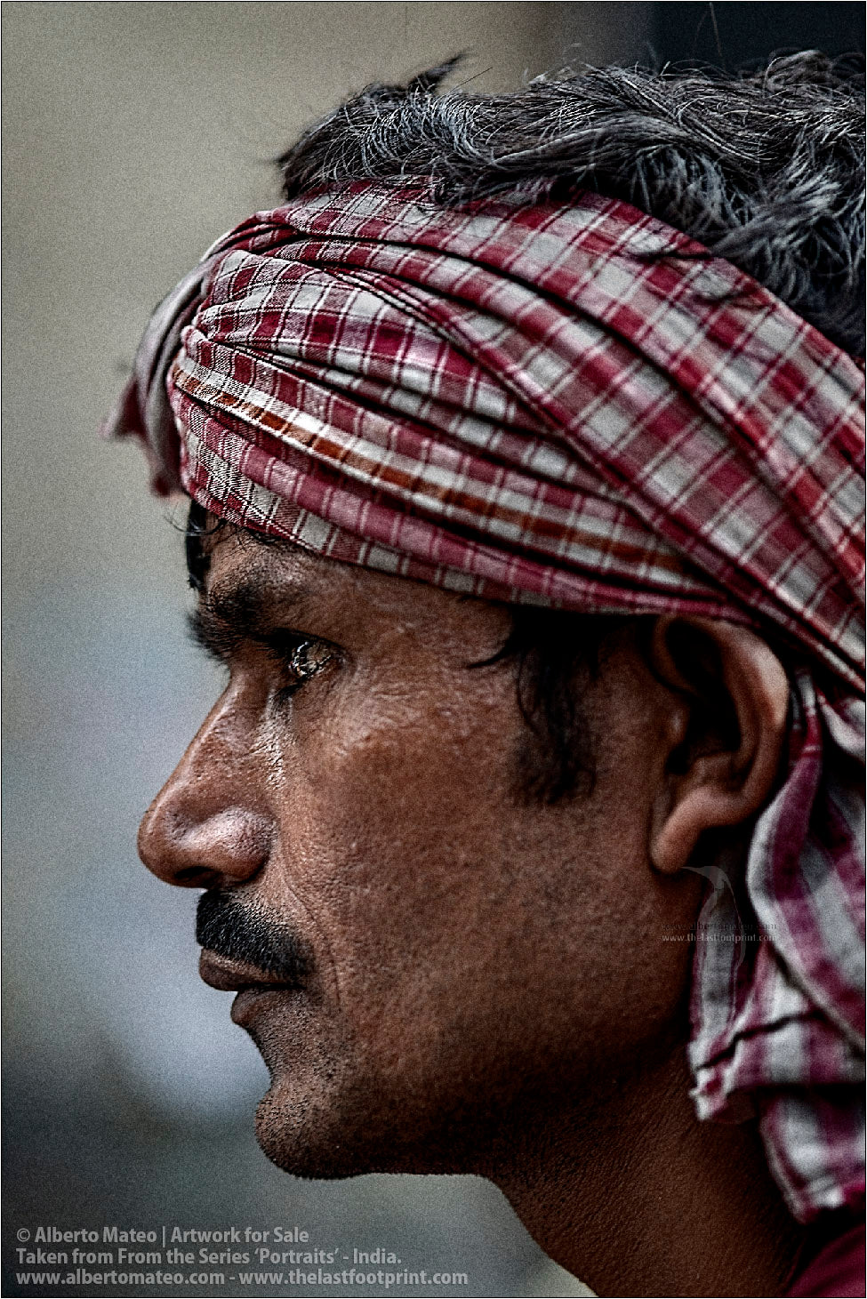 Profile portrait of Porter in Bara Bazar streets, Kolkata, India.