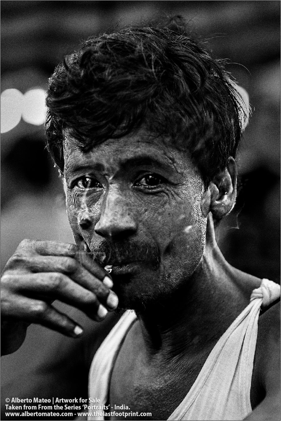 Portrait of smoking Porter, Bara Bazar, Kolkata, India.