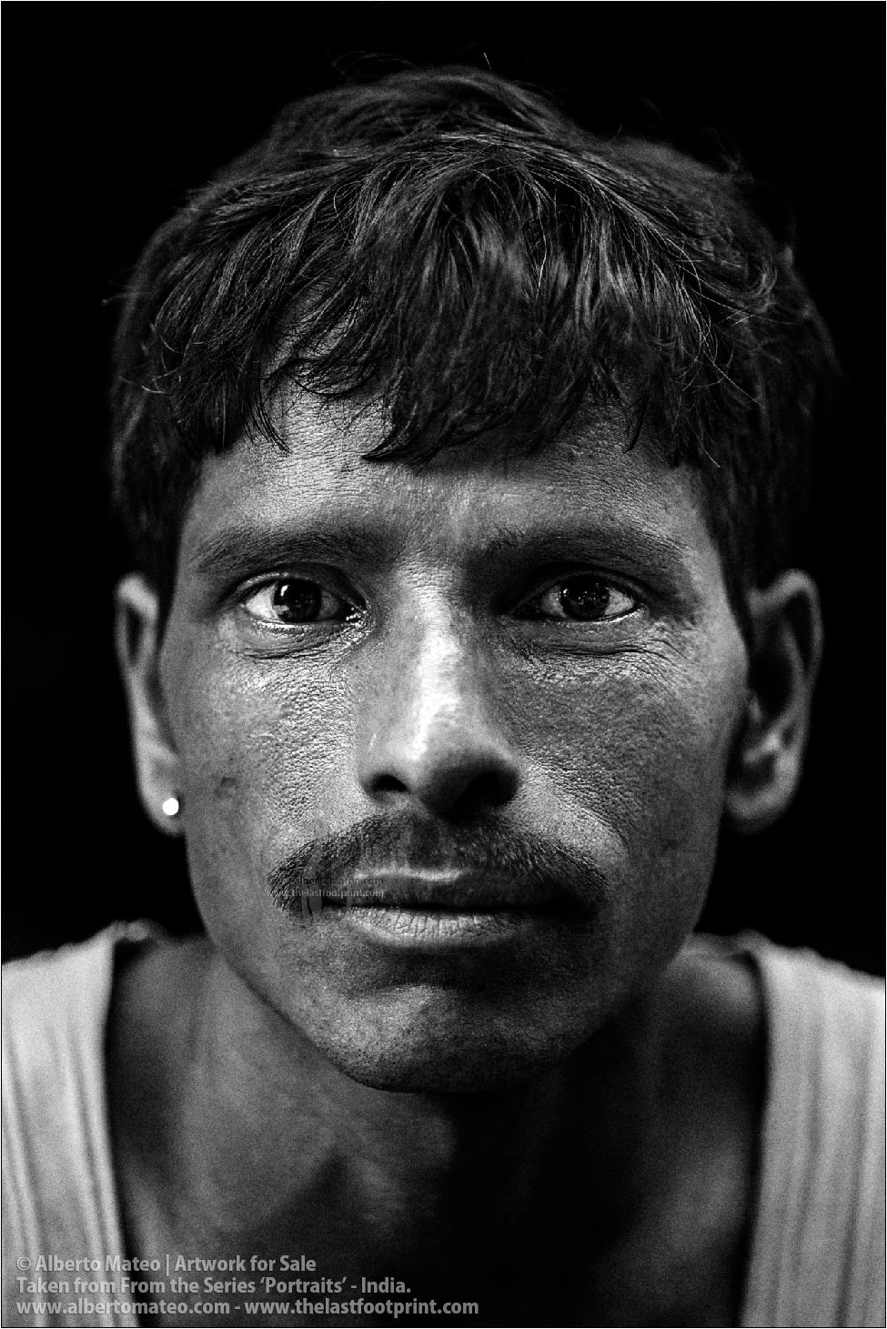 Portrait of young Porter in Bara Bazar streets, Kolkata, India.