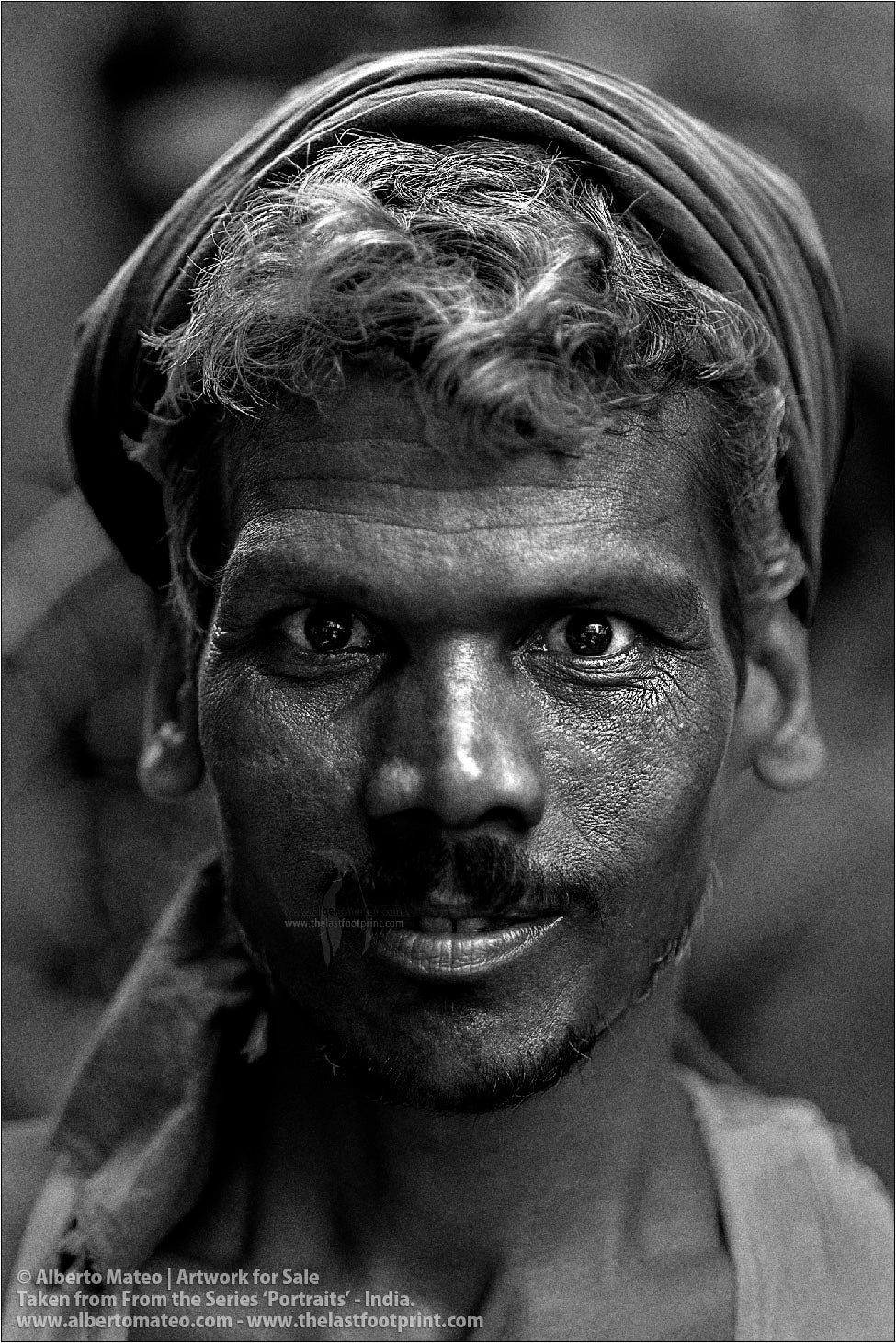 Portrait of Smiling Porter in Bara Bazar streets, Kolkata, India.