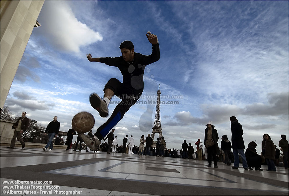 Boy playing soccer at Trocadero, Paris, France.
