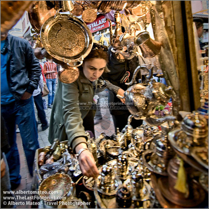 Woman buying in Egyptian (or Spice Bazaar), Istanbul, Turkey. | Cropped Square.