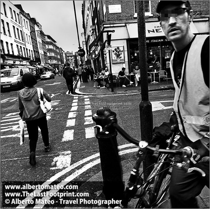 Delivery man with bicycle in the SOHO, London, UK.