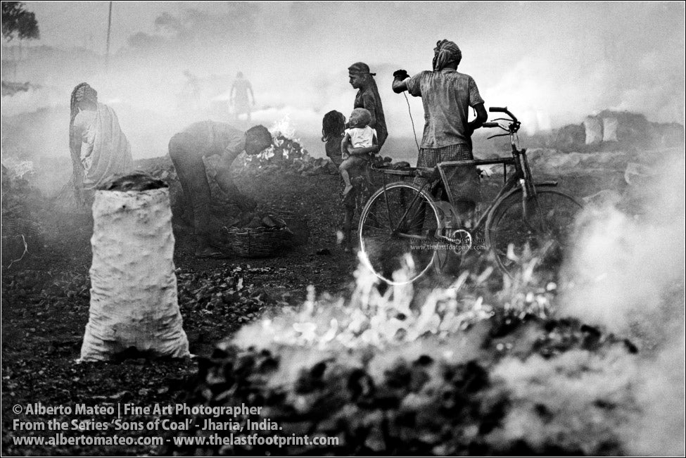 Men loading a Bicycle among Fires, Sons of Coal Series.