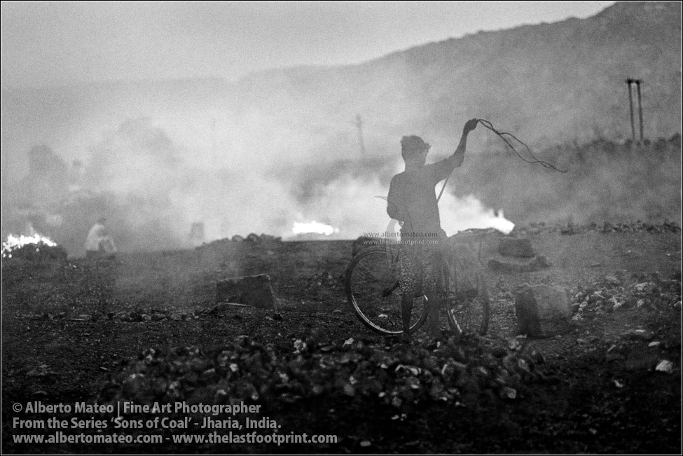 Boy tying Coal Bags on Bicycle, Sons of Coal Series.