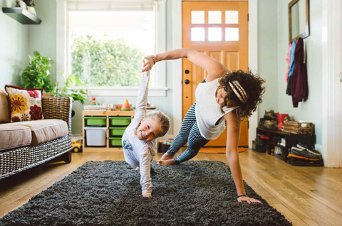 Mother daughter duo doing fun exercises at home