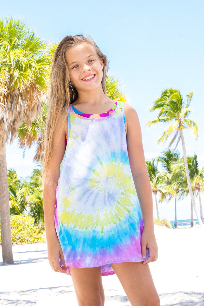 Young girl wearing Limeapple's tofino tye die swim cover up on the beach