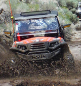 Hisun Strike 900 UTVs in the mud