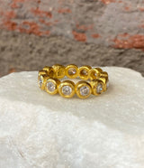 Ara Brilliant Cut Diamond and 24kt Gold Eternity Band
