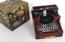 Music box in the shape of old-fashioned nostalgic typewriter. And draws for jewelry too. Can Great Mother's Day gift