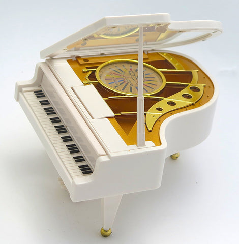 Music box with spinning dancing moving ballerina on top of piano when music is playing. A great Mother's Day gift