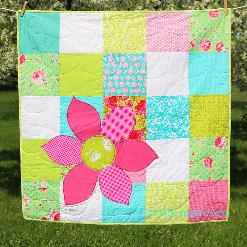 handmade flower on patchwork quilt