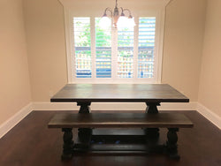 Milled trestle base dining table