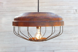 Repurposed chicken feeder light fixture
