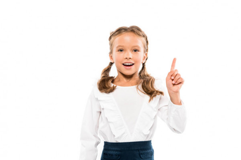 young kid holding her finger up