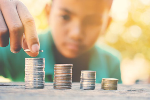 kid stacking coins