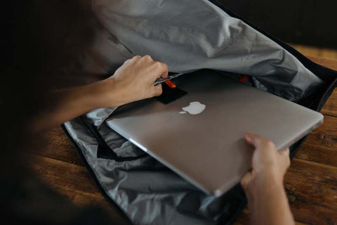 Pulling apple laptop out of the laptop sleeve