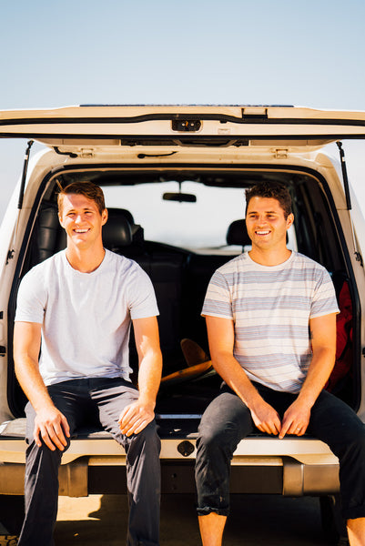 Founders Rory and Jeff sitting on the back of a land cruiser