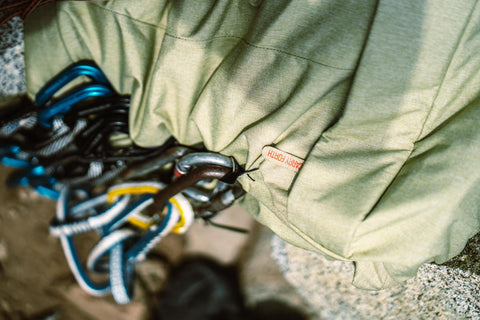 Climbing gear hooked on bag daisy chains