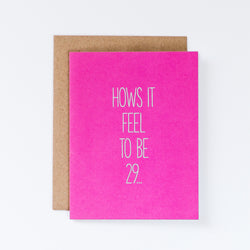 bright bold magenta pink card reads hows it feel to be 29... and on the inside reads again! this snarky and funny birthday card for her is paired with a kraft envelope.
