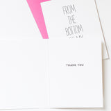 inside view of brilliant white recycled paper thank you card reads from the bottom of my heart hand lettered on the outside, inside reads thank you, card is paired with a bold magenta pink envelope
