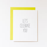 let's celebrate you! a2 greeting card white with black hand lettering. paired with a bold wasabi green envelope
