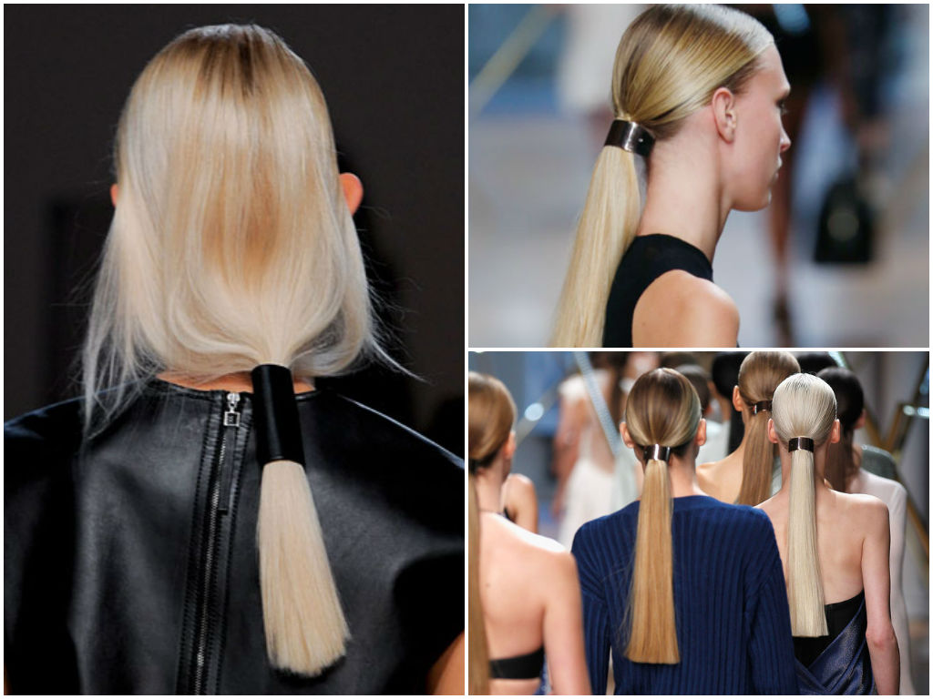 "these sleek ponytails feel very ""high fashion"" thanks to the banded cuff-like accessories worn around them."