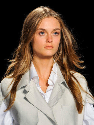 this BCBG model shows the beauty of under-done hair, a style easily created with a large curling iron.