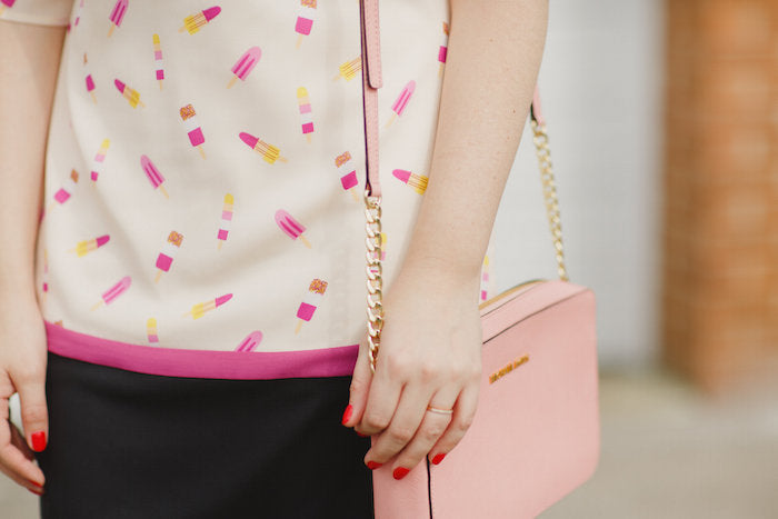 popsicle print dress and pink purse