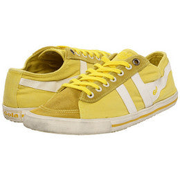 brightly colored sneakers are a must.-- make your feet pop here.