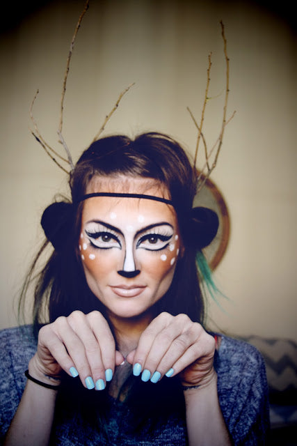 """the cute deer"" is an incredibly popular costume this year. finish this look with a brown bodysuit and some stick antlers. watch the entire tutorial here."