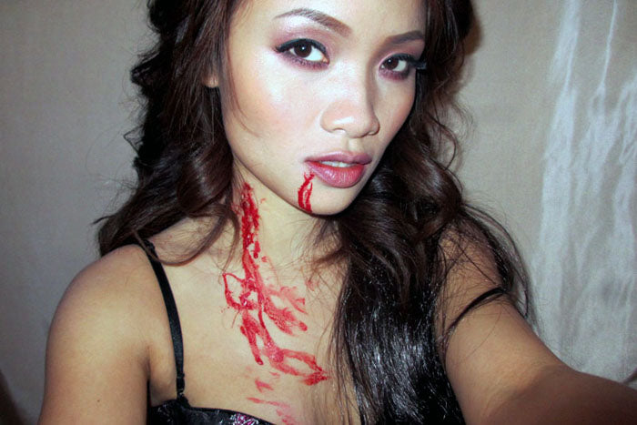 The best vampire is the new vampire. Putting fake blood on your neck (as well as coming from your mouth) tells a story.