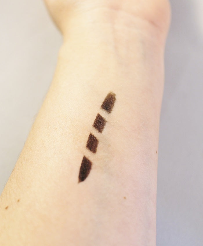 here you can see a swatch of the black liner, plus three crisp lines made by the corrector side of the tool.