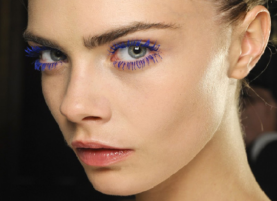 you should recognize this pretty face: i'm obsessed with cara delevigne and these purple lashes have only furthered my love.