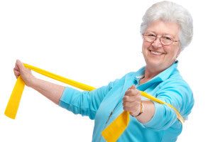 senior woman doing chest exercises for resistance bands