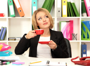 Beautiful young business woman at lunch break in office