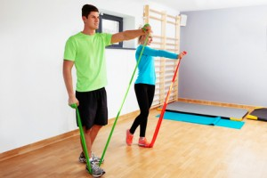 Two young people exercising with resistance bands