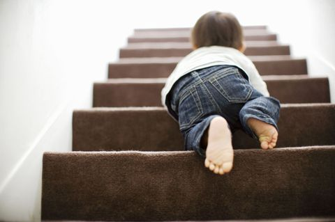 Safety First as Baby Learns to Climb Stairs