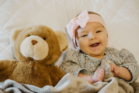 Baby Laughing with Teddy Bear