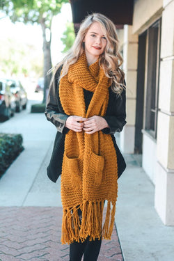 Two pocket oversize tassel scarf.