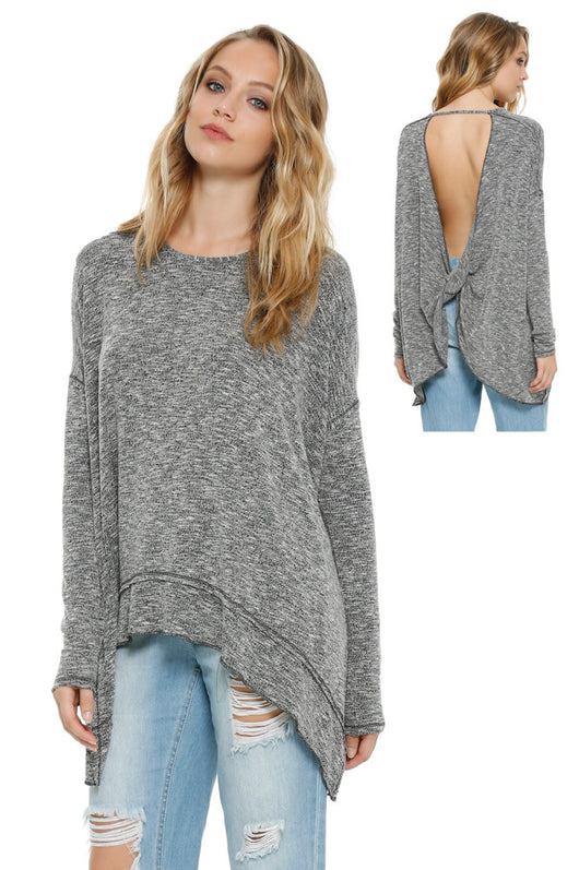 Long sleeve shirt low cut back with a twist.