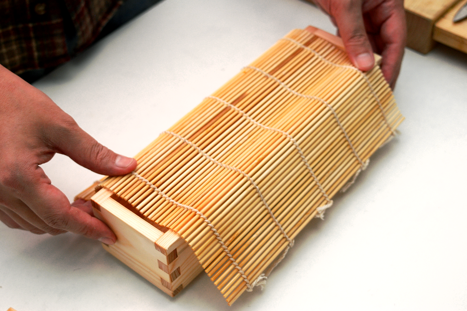 Sushi Rolling Mat (called Makisu) is a Japanese traditional cooking tool that is made of bamboo and strings.