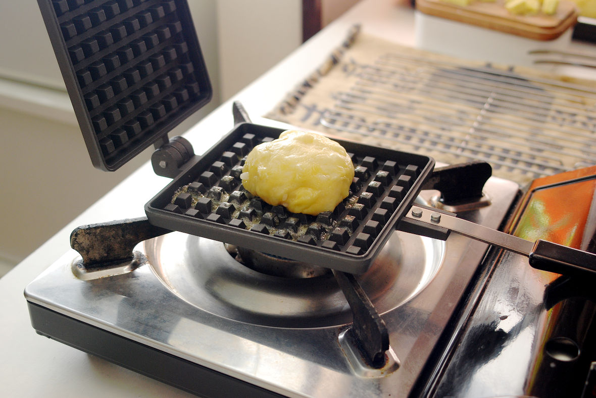 Pre-heat the waffle iron and spread butter (not included in the ingredients above), put the dough there to bake for 3 mins over low heat.