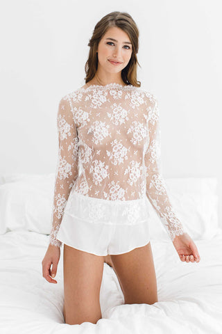 Swan Queen lace crop top in ivory white or black.