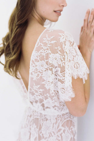 Harlow Long lace robe with open back and flutter sleeves in Ivory