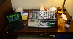 Small Eurorack synthesizer on a hotel desk