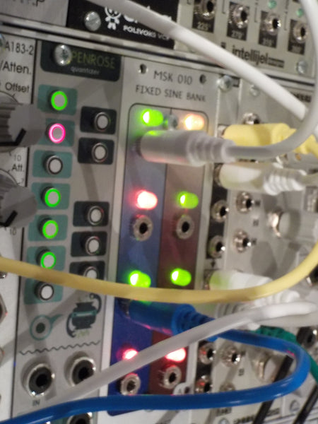 MSK 010 Fixed Sine Bank module in a synthesizer rack, with glowing lights